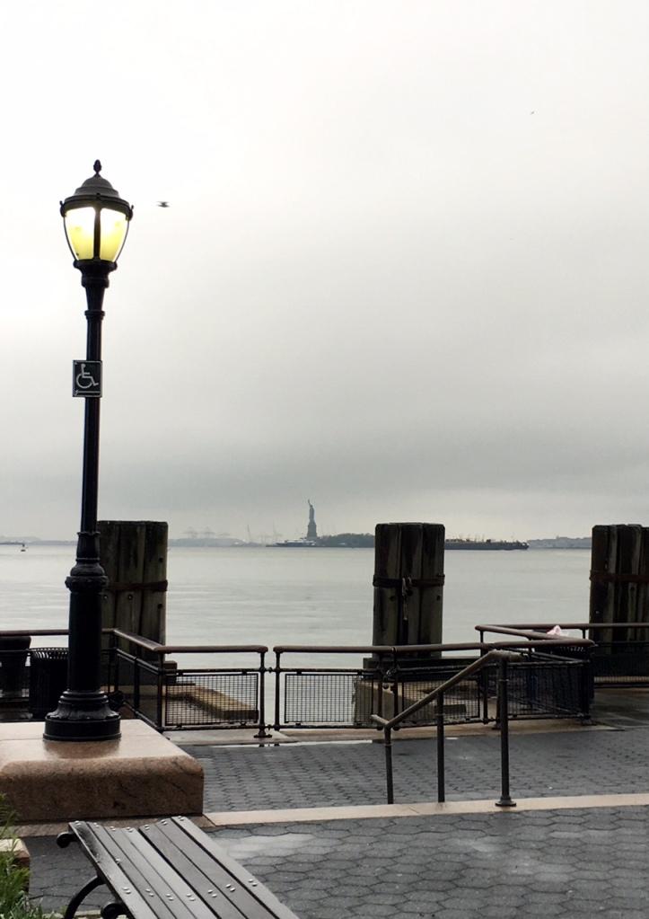 Greaaaattt big lamp post. Teeeeeeny tiny Statue of Liberty.